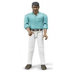 Figurka - Muž (snědá pleť), bílé kalhoty a modrá košile 60003 BRUDER